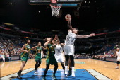 Crystal Langhorne of the Seattle Storm blocks a shot against Lindsay Whalen of the Minnesota Lynx during the WNBA game on June 29 2014 at Target...