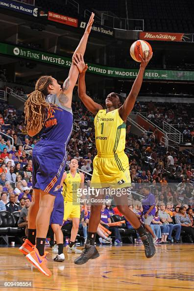 Crystal Langhorne of the Seattle Storm drives to the basket and shoots the ball over Brittney Griner of the Phoenix Mercury on September 15 2016 at...