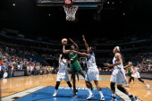Crystal Langhorne of the Seattle Storm goes for the shot against Damiris Dantas of the Minnesota Lynx during the WNBA game on June 29 2014 at Target...