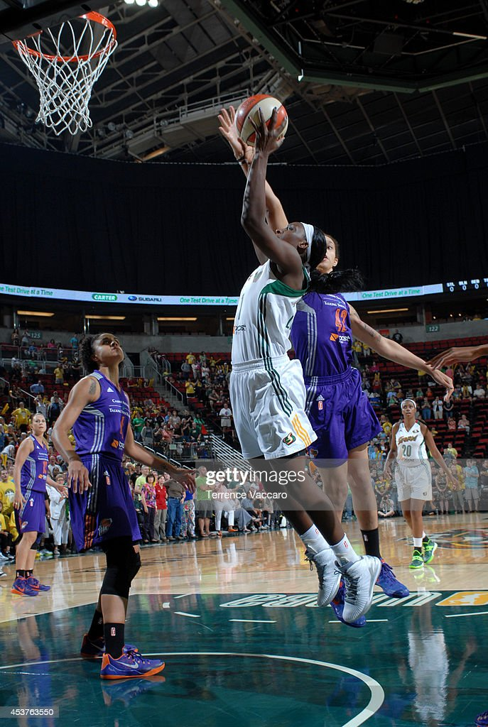Crystal Langhorne #1 of the Seattle Storm goes to the basket against Brittney Griner #42 of Phoenix Mercury during the game on August 17, 2014 at Key Arena in Seattle, Washington.