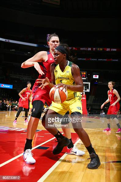 Crystal Langhorne of the Seattle Storm handles the ball against Stefanie Dolson of the Washington Mystics on September 9 2016 at Verizon Center in...