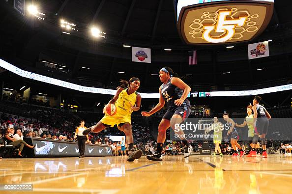 Crystal Langhorne of the Seattle Storm handles the ball against Markeisha Gatling of the Atlanta Dream during Round One of the 2016 WNBA Playoffs on...