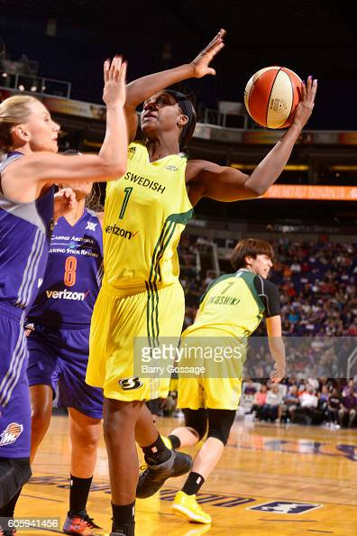 Crystal Langhorne of the Seattle Storm handles the ball against Penny Taylor of the Phoenix Mercury on September 15 2016 at Talking Stick Resort...