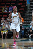 Crystal Langhorne of the Seattle Storm runs the court against the San Antonio Silver Stars during the game on August 3 2014 at Key Arena in Seattle...