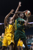 Crystal Langhorne of the Seattle Storm shoots against Glory Johnson of the Tulsa Shock during the WNBA game on June 15 2014 at the BOK Center in...