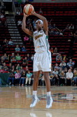 Crystal Langhorne of the Seattle Storm shoots against the Minnesota Lynx on June 27 2014 at Key Arena in Seattle Washington NOTE TO USER User...