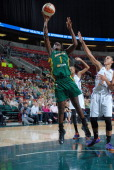 Crystal Langhorne of the Seattle Storm shoots against the Phoenix Mercury during the game on July 222014 at Key Arena in Seattle Washington NOTE TO...