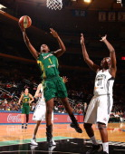 Crystal Langhorne of the Seattle Storm shoots against Tina Charles of the New York Liberty during a game at Madison Square Garden in New York City on...