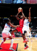 Crystal Langhorne of the Washington Mystics attempts a shot during a game against the Atlanta Dream at Phillips Arena on September 19 2013 in Atlanta...