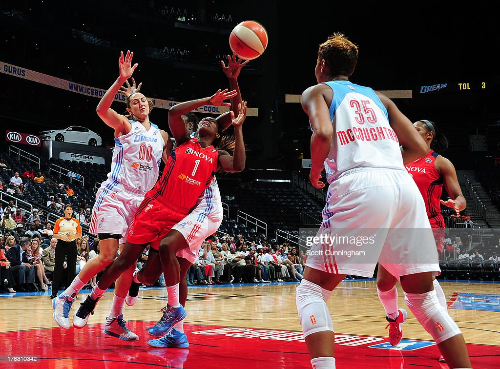 Crystal Langhorne #1 of the Washington Mystics battles for a loose ball against the Atlanta Dream at Philips Arena on August 28 2013 in Atlanta, Georgia.