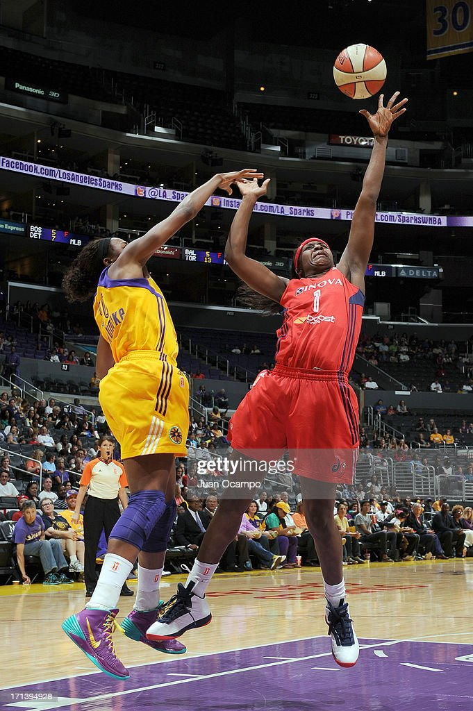 Crystal Langhorne #1 of the Washington Mystics battles for the ball control against Nneka Ogwumike #30 of the Los Angeles Sparks during the game at Staples Center on June 23, 2013 in Los Angeles, California.