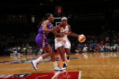 Crystal Langhorne of the Washington Mystics drives against Jantel Lavender of the Los Angeles Sparks at the Verizon Center on August 4 2013 in...
