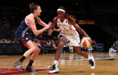 Crystal Langhorne of the Washington Mystics drives against Kelsey Griffin of the Connecticut Sun at the Verizon Center on August 11 2013 in...