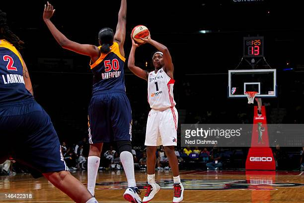 Crystal Langhorne of the Washington Mystics shoots against Jessica Davenport of the Indiana Fever at the Verizon Center on June 15 2012 in Washington...