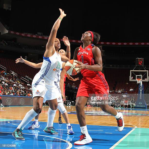 Crystal Langhorne of the Washington Mystics shoots against Kia Vaughn of the New York Liberty during a game on September 1 2012 at the Prudential...