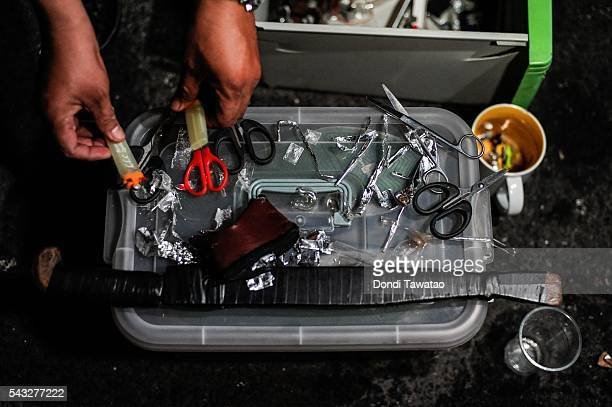 Crystal meth and various drug paraphernalia are seized by undercover police during a night time raid on a suspected drug den on June 16 2016 in...