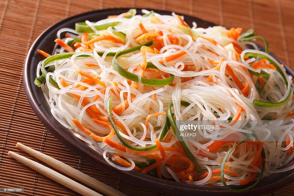 crystal noodles with cucumber and carrot on a plate close-up : Stock Photo