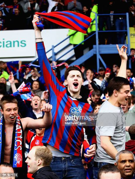 Crystal Palace fan celebrates after his team avoided relegation following a draw with Sheffield Wednesday in the CocaCola Championship match between...