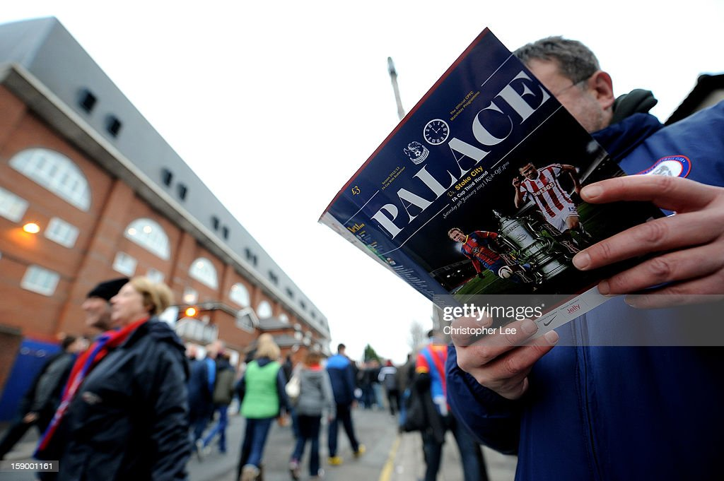 A Crystal Palace fan reads his match programme prior to the FA Cup with Budweiser Third Round match between Crystal Palace and Stoke City at Selhurst Park on January 5, 2013 in London, England.