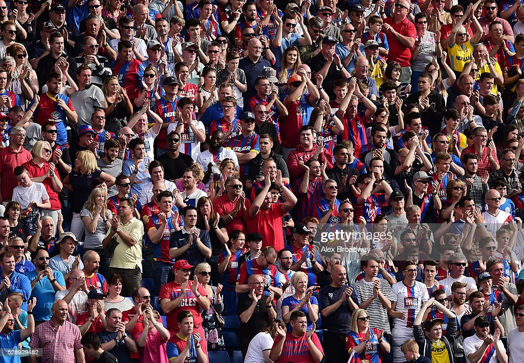 Crystal Palace fans applaud their team during the Barclays Premier League match between Crystal Palace and Stoke City at Selhurst Park on May 7, 2016 in London, England.
