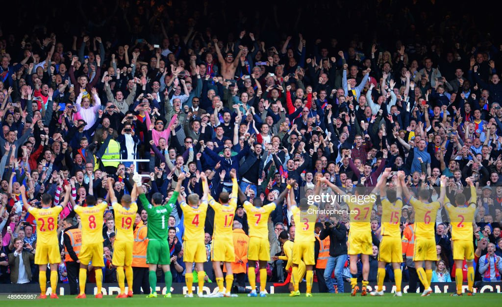 Crystal Palace fans celebrate victory with their fans during the Barclays Premier League match between West Ham United and Crystal Palace at Boleyn Ground on April 19, 2014 in London, England.