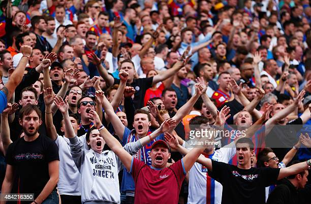 Crystal Palace fans cheer during the Barclays Premier League match between Crystal Palace and Arsenal at Selhurst Park on August 16 2015 in London...