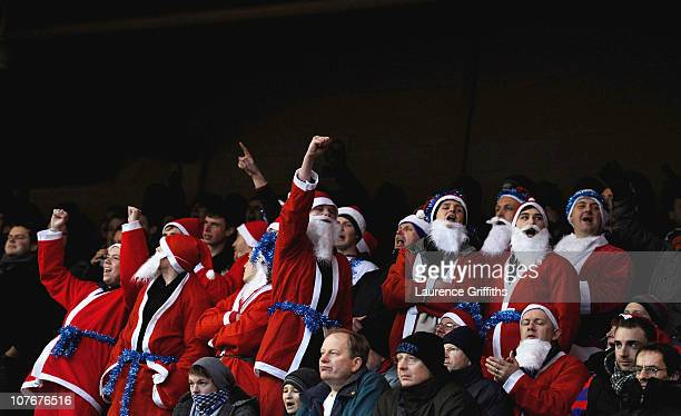 Crystal Palace fans dressed in Santa costumes brave the freezing temperatures during the npower Championship match between Nottingham Forest and...