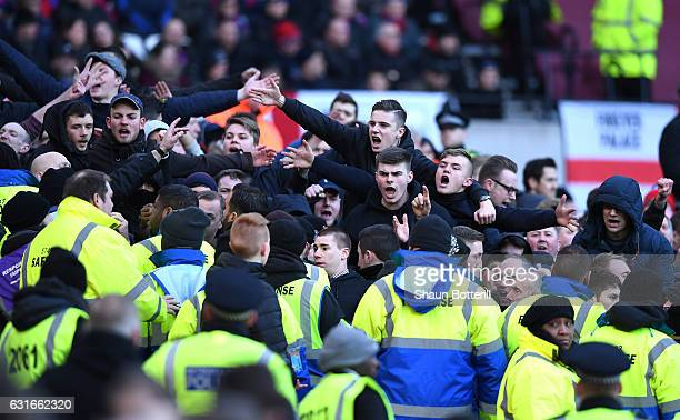Crystal Palace fans shout abuse at the West Ham fans during the Premier League match between West Ham United and Crystal Palace at London Stadium on...