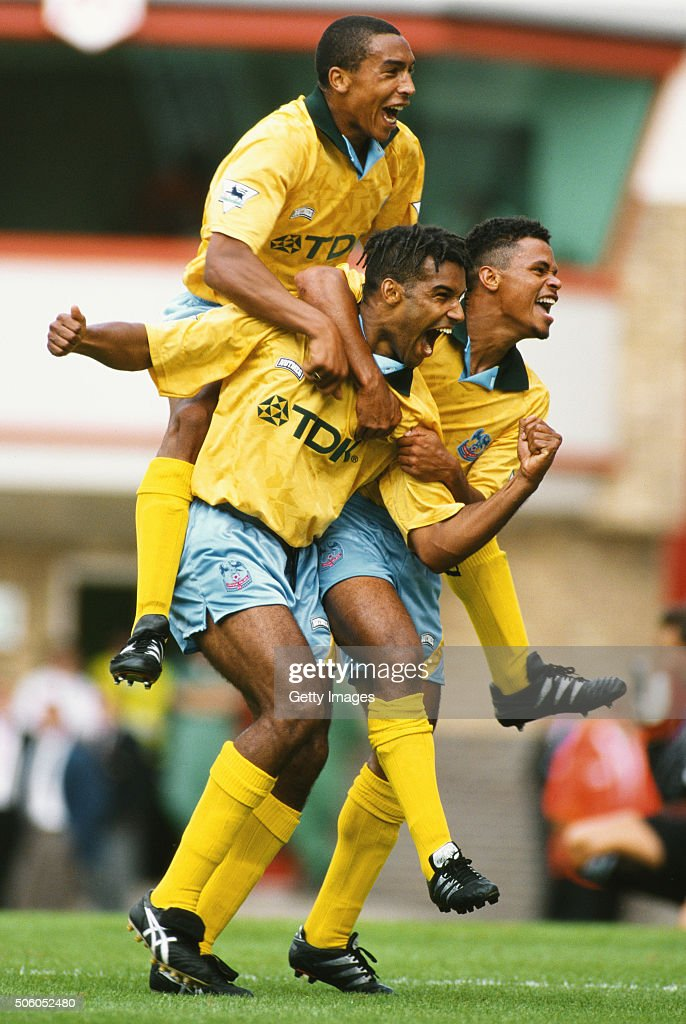 Crystal Palace forward Andy Preece (c) celebrates with team mates <a gi-track='captionPersonalityLinkClicked' href=/galleries/search?phrase=Chris+Armstrong&family=editorial&specificpeople=661189 ng-click='$event.stopPropagation()'>Chris Armstrong</a> (top) and John Salako after the second goal against Arsenal at Highbury during the Tony Adams testimonial on August 13, 1994 in London, England.