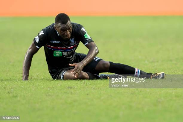 Crystal Palace forward Christian Benteke sits on the pitch during the Premier League Asia Trophy match between West Brom and Crystal Palace at Hong...