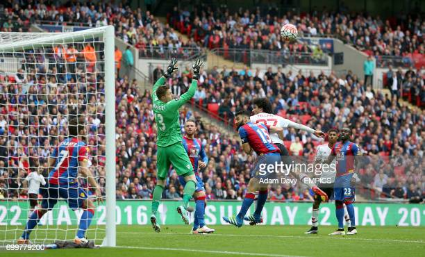Crystal Palace goalkeeper Wayne Hennessey jumps as Manchester United's Marouane Fellaini makes an attempt on goal