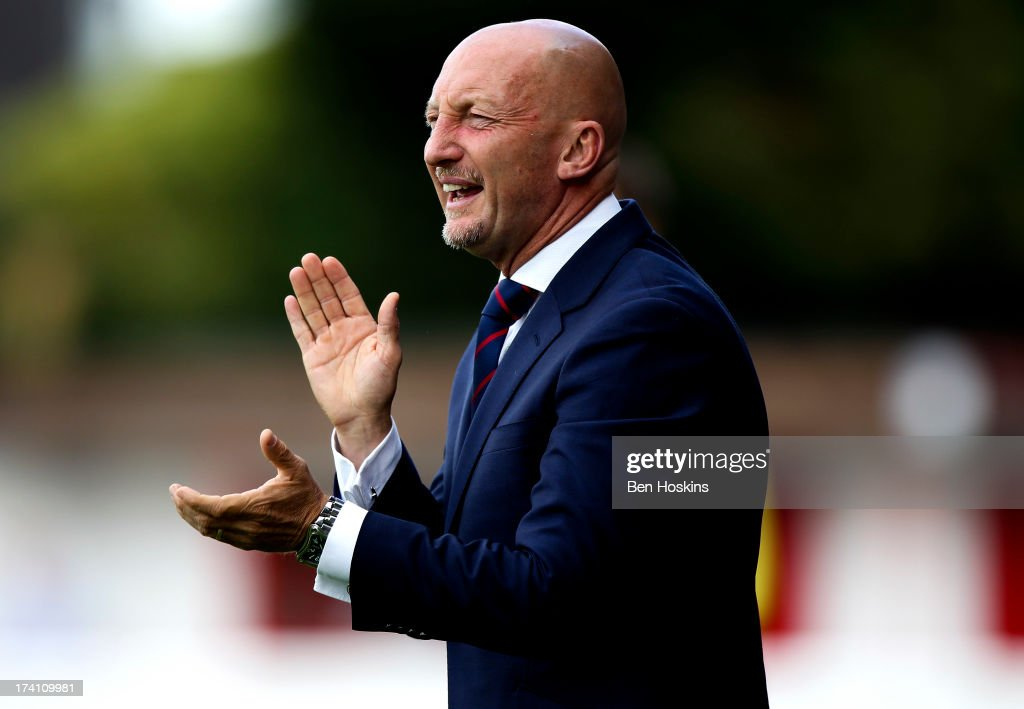 Crystal Palace manager <a gi-track='captionPersonalityLinkClicked' href=/galleries/search?phrase=Ian+Holloway&family=editorial&specificpeople=235580 ng-click='$event.stopPropagation()'>Ian Holloway</a> applauds his side during a pre season friendly match between Dagenham and Redbridge and Crystal Palace at The London Borough of Barking and Dagenham Stadium on July 20, 2013 in Dagenhm, England.