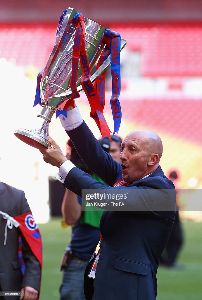 Crystal Palace Manager Ian Holloway celebrates his team's promotion with the trophy at the end of the npower Championship Play-off Final match between Watford and Crystal Palace at Wembley Stadium on May 27, 2013 in London, England.