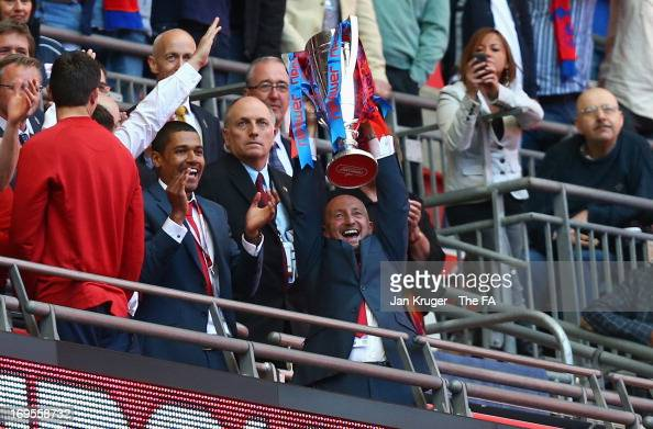 Crystal Palace Manager Ian Holloway celebrates his team's promotion with the trophy at the end of the npower Championship Playoff Final match between...