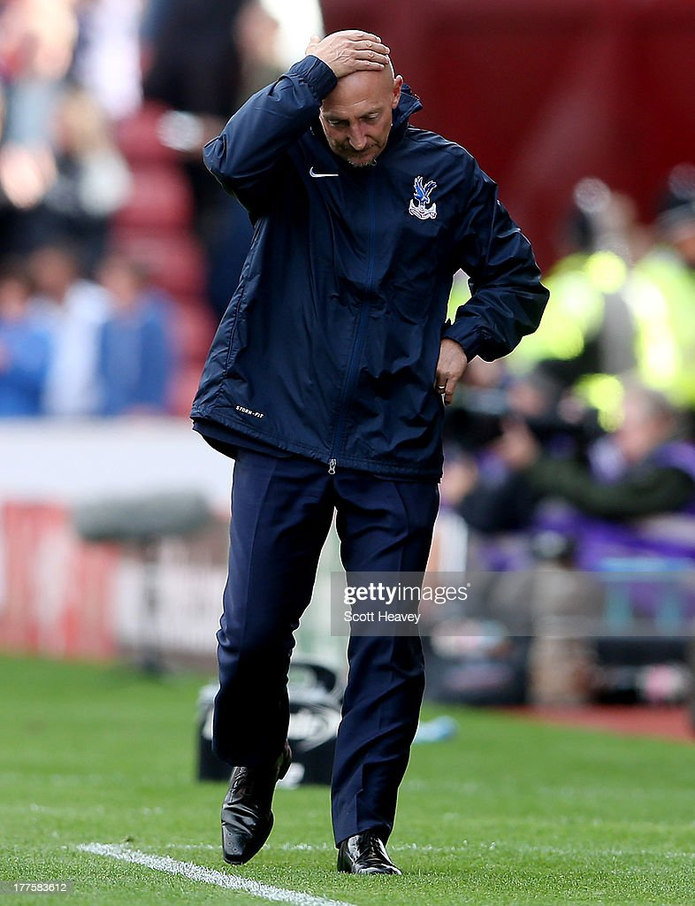 Crystal Palace manager <a gi-track='captionPersonalityLinkClicked' href=/galleries/search?phrase=Ian+Holloway&family=editorial&specificpeople=235580 ng-click='$event.stopPropagation()'>Ian Holloway</a> looks dejected during the Barclays Premier League match between Stoke City and Crystal Palace at Britannia Stadium on August 24, 2013 in Stoke on Trent, England.