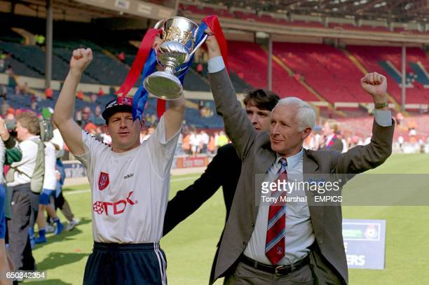 Crystal Palace manager Steve Coppell and chairman Ron Nodes celebrate with the trophy