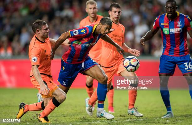 Crystal Palace midfielder Ruben LoftusCheek competes for the ball with Liverpool FC players during the Premier League Asia Trophy match between...