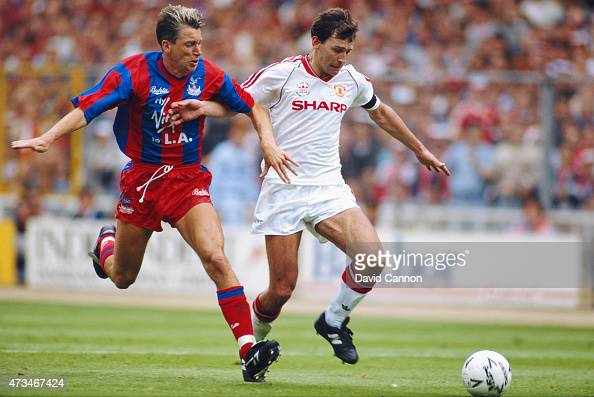 Crystal Palace player Alan Pardew challenges Bryan Robson during the 1990 FA Cup final between Crystal Palace and Manchester United at Wembley...