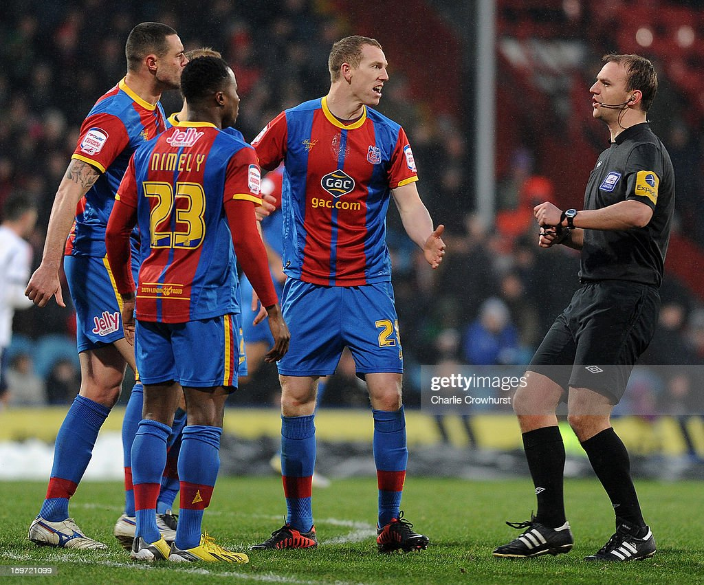 Crystal Palace players crowd ref Rob Madley after they feel they should have been given a penalty during the npower Championship match between Crystal Palace and Bolton at Selhurst Park on January 19, 2013 in London England.