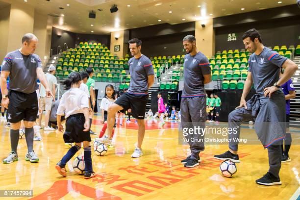 Crystal Palace players Luka Milivojevic l Ruben LoftusCheek and Scott Dann attend the Premier League Asia Trophy Skills Session at Macpherson Stadium...