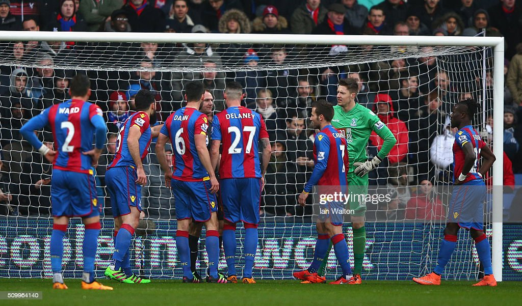 Crystal Palace players protest against the penalty decision by referee Robert Madley during the Barclays Premier League match between Crystal Palace and Watford at Selhurst Park on February 13, 2016 in London, England.