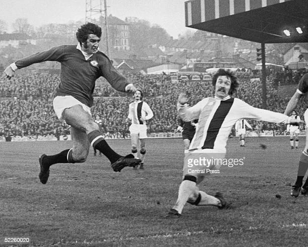 Crystal Palace striker Don Rogers tackes Manchester United forward Ian Moore during a match at Selhurst Park 16th December 1972