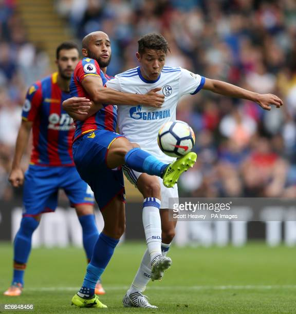 Crystal Palace's Andros Townsend and Schalke's Amine Harit battle for the ball during the preseason friendly match at Selhurst Park London