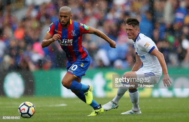 Crystal Palace's Andros Townsend and Schalke's Fabian Reese battle for the ball during the preseason friendly match at Selhurst Park London