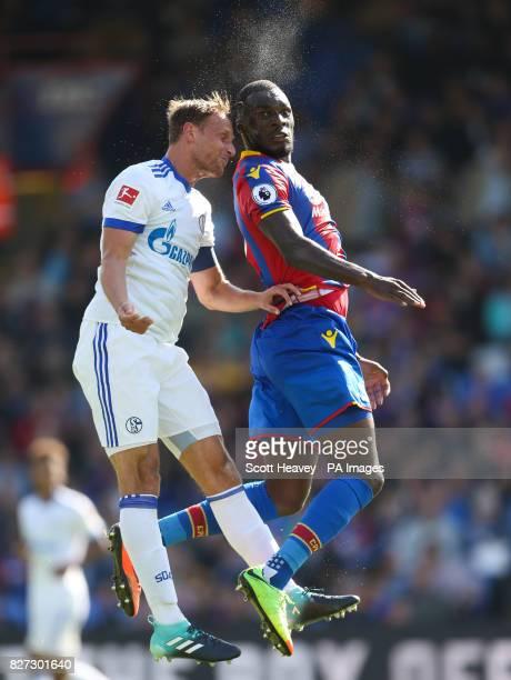 Crystal Palace's Christian Benteke and FC Schalke's Benedikt Howedes during the preseason friendly match at Selhurst Park London
