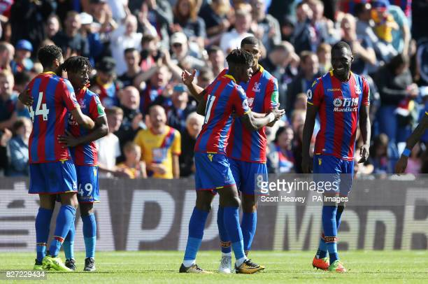 Crystal Palace's Christian Benteke celebrates with teammates after scoring their first goal during the preseason friendly match at Selhurst Park...