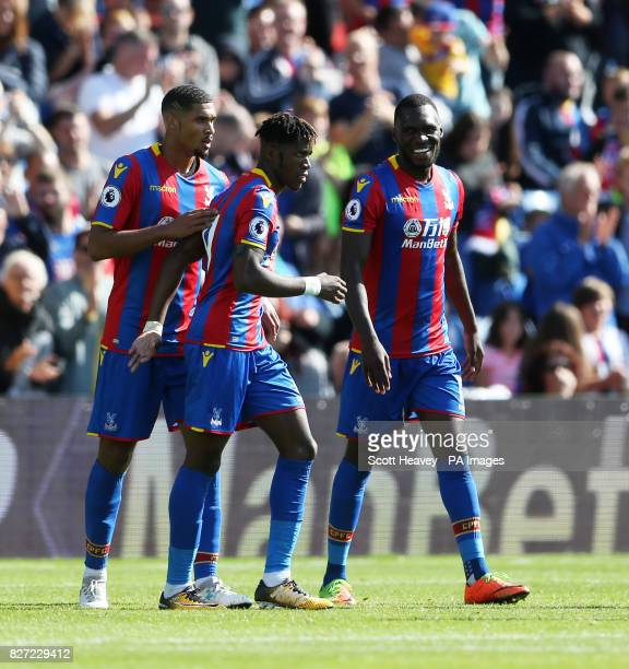Crystal Palace's Christian Benteke celebrates with Wilfried Zaha and Ruben Loftus Cheek after scoring their first goal during the preseason friendly...