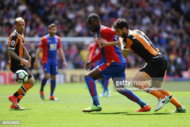 Crystal Palace's Christian Benteke holds off the challenge from Hull City's Andrea Ranocchia during the Premier League match between Crystal Palace...