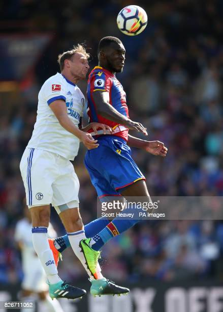 Crystal Palace's Christian Benteke in action with Schalke's Johannes Geis during the preseason friendly match at Selhurst Park London