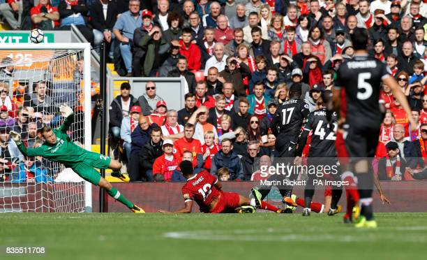 Crystal Palace's Christian Benteke shoots over the bar during the Premier League match at Anfield Liverpool